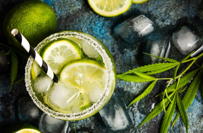 Lime cocktails with marijuana on stone table stock photography
