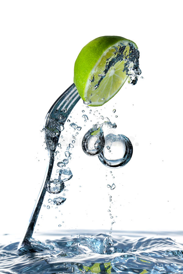 Lime and fork stock image