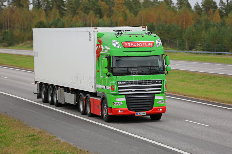 Lime Green DAF Reefer Truck on Motorway. PAIMIO, FINLAND - SEPTEMBER 23, 2016: Lime green DAF XF reefer truck of Braunstein moving along freeway in South of royalty free stock photo