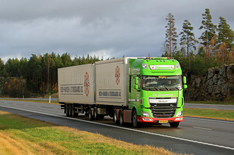 Lime Green DAF XF Full Trailer Truck on Motorway stock photography
