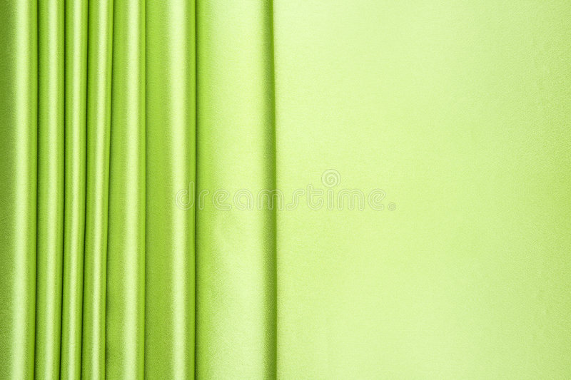 Lime green satin stripes pattern. The lime green satin is arranged in stripes pattern with more than half for copy space, can be use for background, card design stock image
