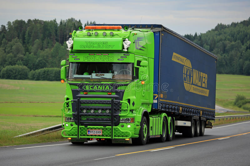 Lime Green Scania Semi Show Truck on the Road stock photo