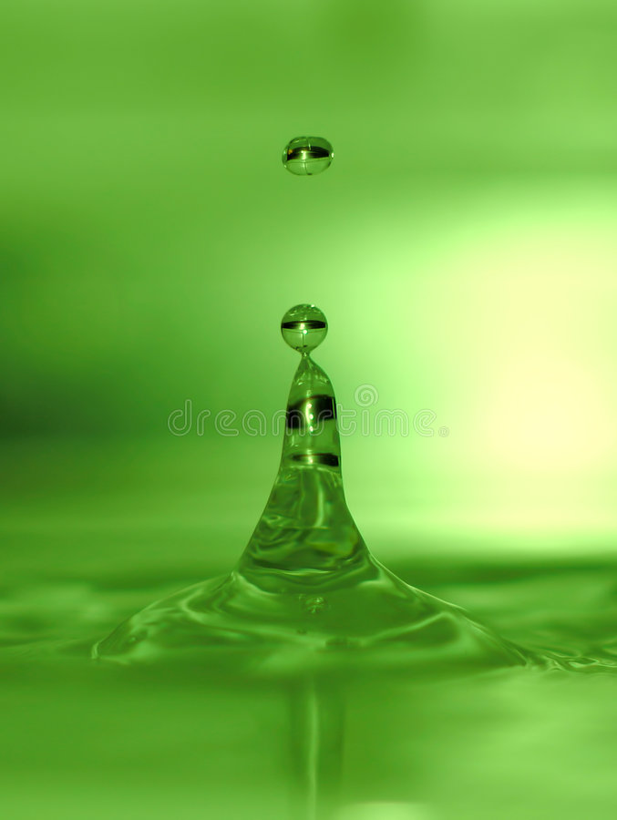 Lime green water drops royalty free stock photography