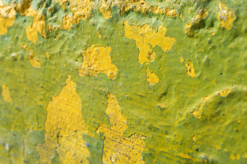Lime green and yellow textured wall stock image