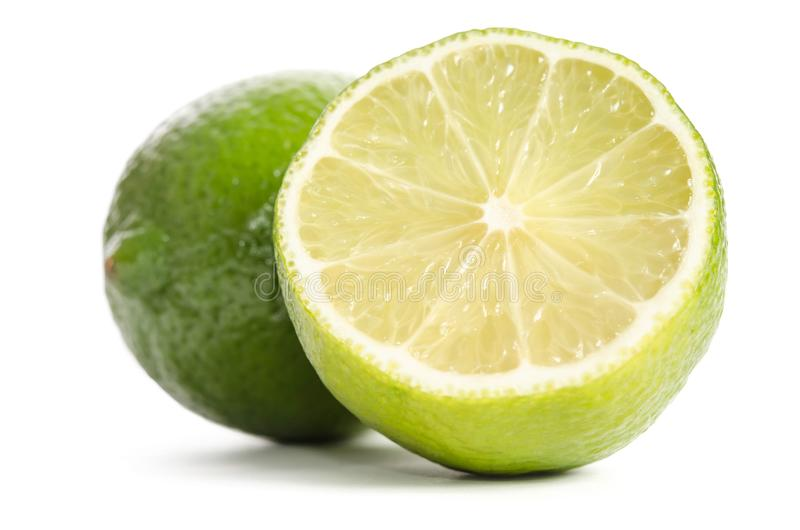 Lime and half of lime. On white background royalty free stock images