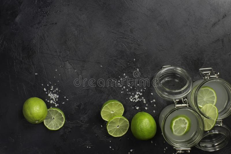 Lime juice in glasses on dark stone stock photography