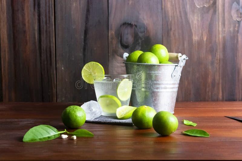 Lime juice or lime lemonade or green lemon with lemon tank on wooden table. royalty free stock photo
