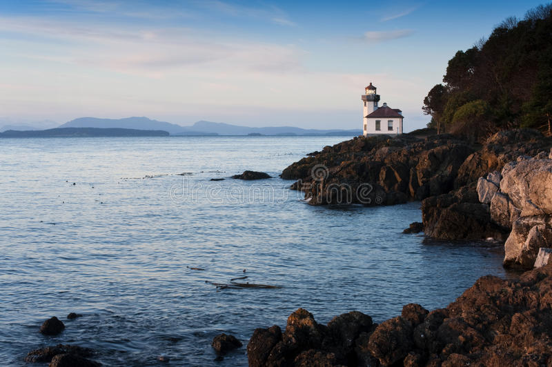Lime Kiln Lighthouse. Situated in the northwest corner of Washington State, the San Juan Islands are breathtaking gems on a gentle sea that attract numerous stock images