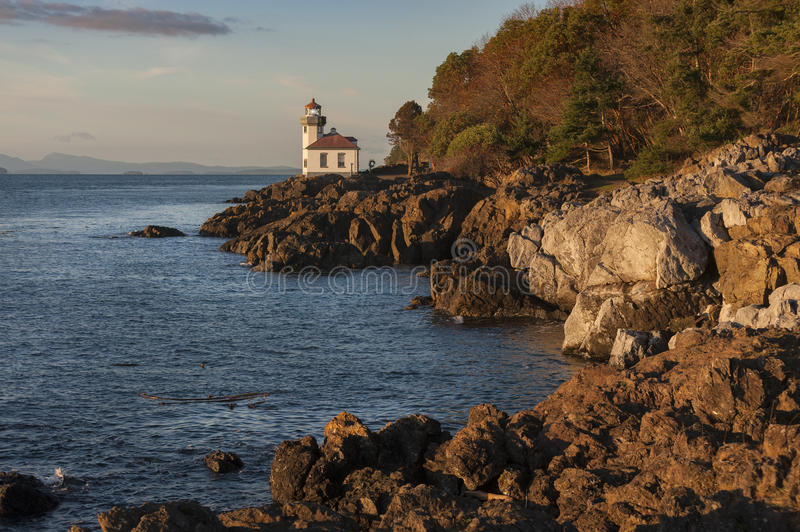 Lime Kiln Lighthouse. The Lime Kiln Light is a functioning navigational aid located on Lime Kiln Point overlooking Dead Man's Bay on the western side of San Juan royalty free stock photography