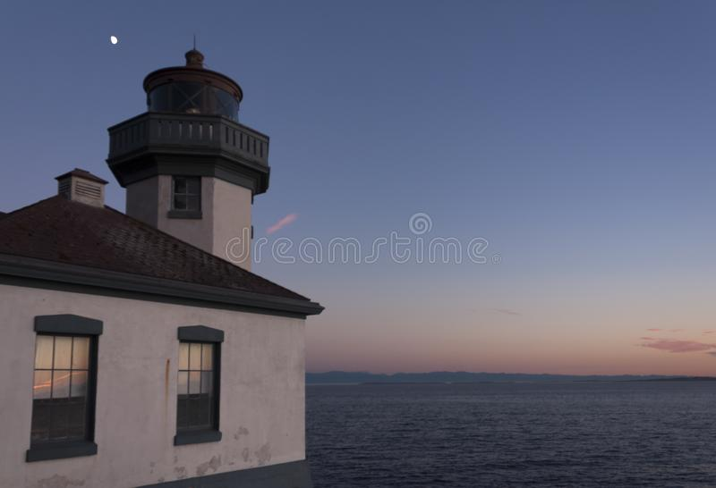 Lime Kiln Lighthouse, San Juan Island, WA. Lime Kiln Lightouse overlooks Haro Strait on San Juan Island, WA. This photo was taken on a clear June evening royalty free stock images