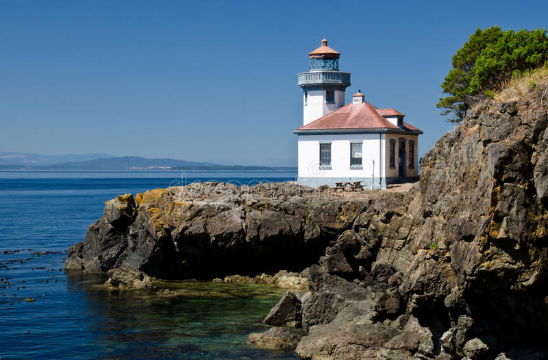 Lime Kiln Lighthouse, USA. Lime Kiln Lighthouse is located in the San Juan Islands, Washington State, USA stock photos