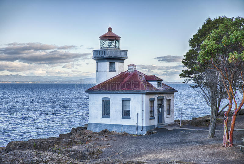 Lime Kiln Point Lighhouse At Dawn. The Lime Kiln Point Lighthouse watc hes over Haro Strait and the Straits of Juan de Fuca. It is known as one of the best stock images
