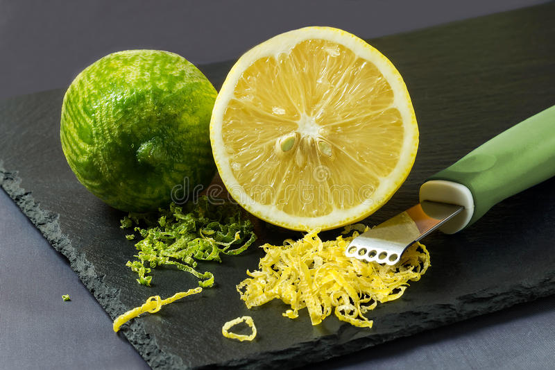 Lime and lemon, citrus zest and knife to peel royalty free stock photos