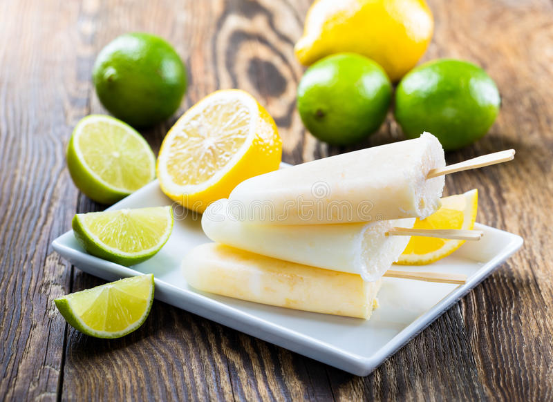 Lime and lemon juice ice pops royalty free stock photo