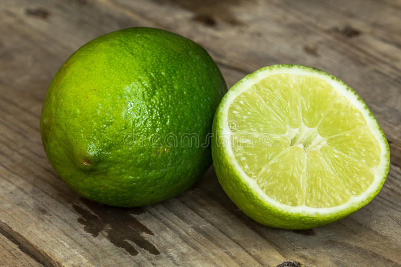 Lime on an old wooden table stock photos