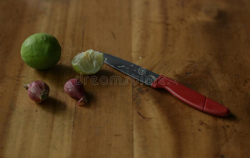 Lime onion and knife. Which must be available in the kitchen as a spice in cooking royalty free stock photos