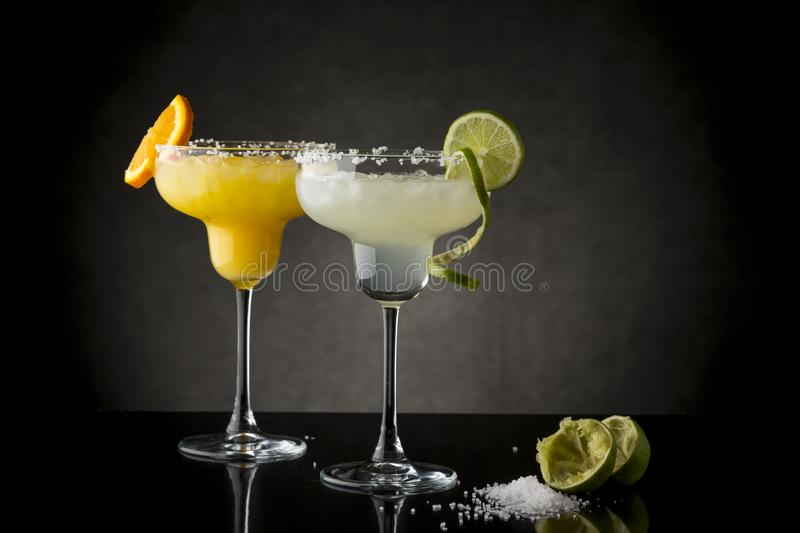 Lime and orange margarita cocktails royalty free stock photography