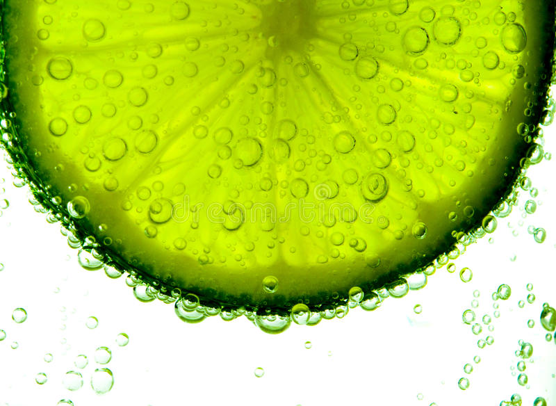 Lime Slice in Clear Fizzy Water Bubble stock photo