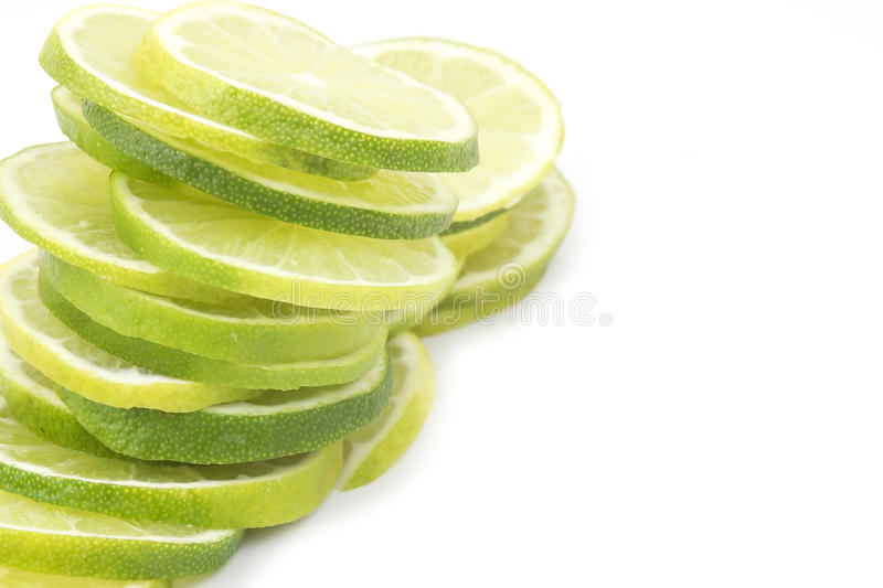 Lime slices. Isolated on white stock photography