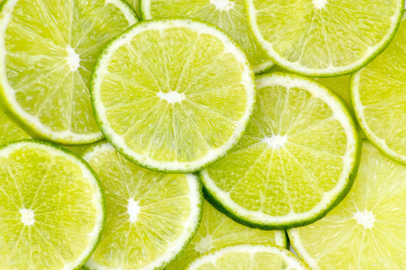 Lime slices. Many fresh lime slices - background royalty free stock photography
