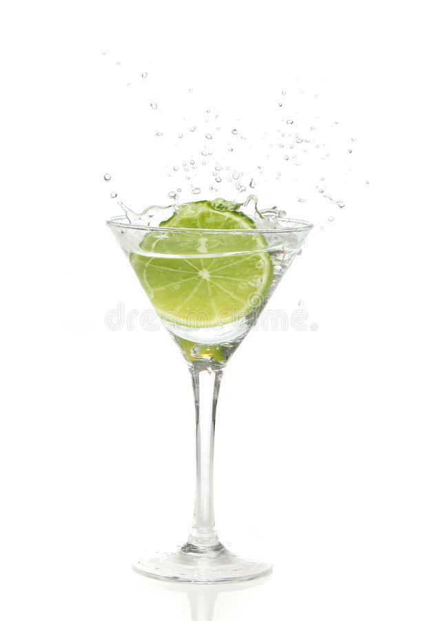 Download Lime Splashing Into A Cocktail Stock Photo - Image of vermouth, vodka: 2451346