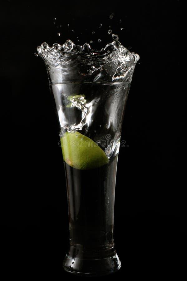 Lime splashing into water stock photo
