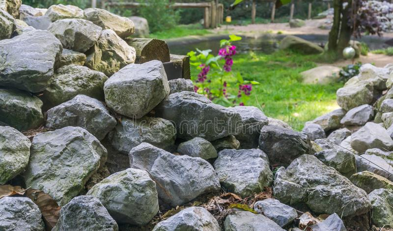 Lime stone rocks stacked pile in a garden beautiful decorative texture background. A lime stone rocks stacked pile in a garden beautiful decorative texture royalty free stock photography