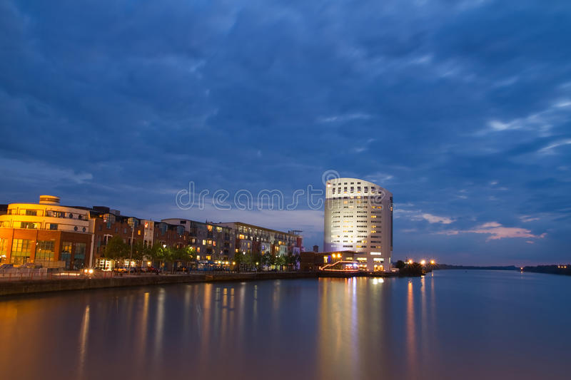 Limerick at dusk. Limerick city view at night with Shannon river stock photo