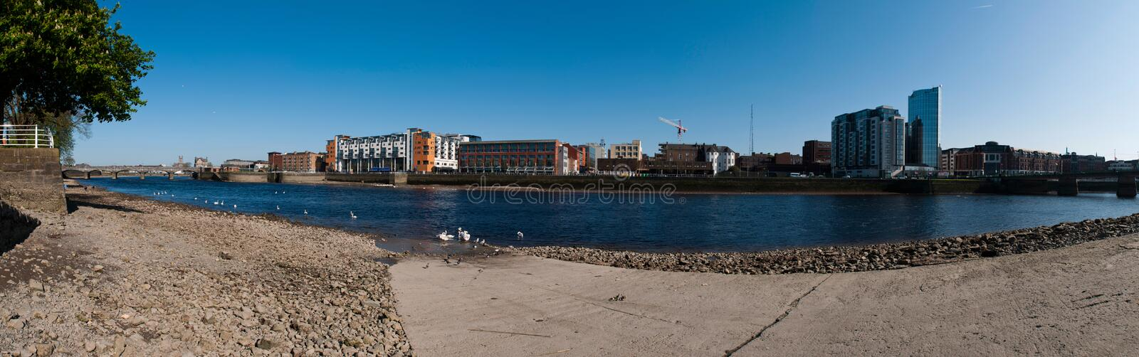 Limerick panorama. Stunning Limerick cityscape panorama from Shannon bridge to Sarsfield Bridge, featuring Riverpoint buildings and river Shannon with swans ( royalty free stock photos