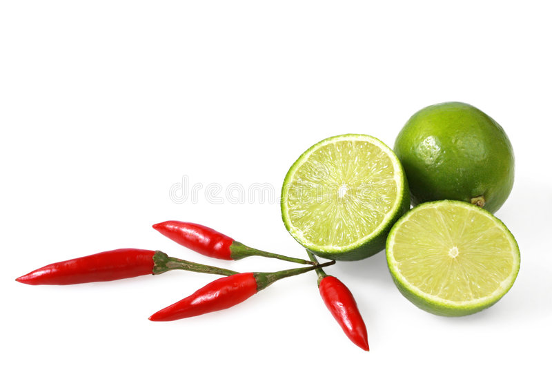 Limes and Chilli Peppers royalty free stock photo
