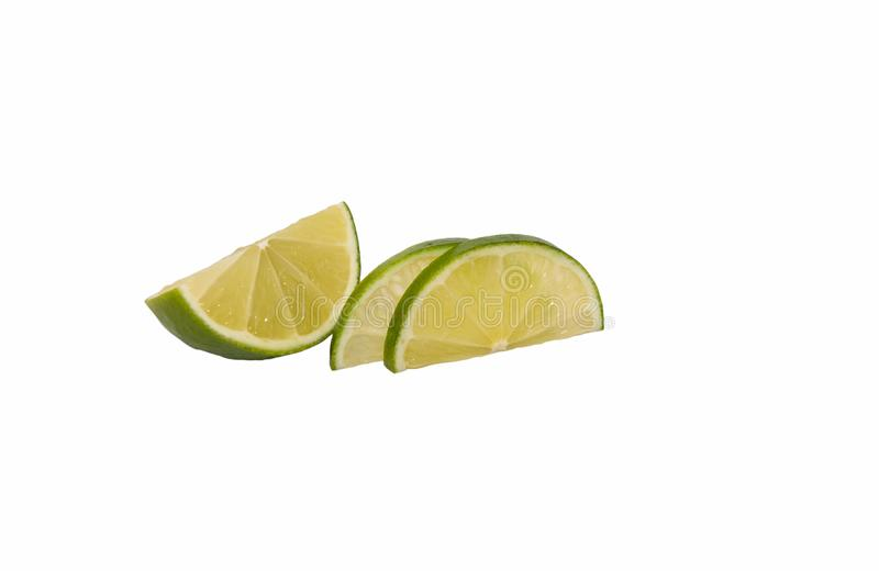 Lime is cut into thin pieces. royalty free stock image
