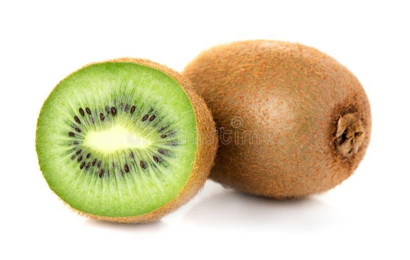 Kiwi slices isolated. Heap of ripe kiwi slices isolated on white background stock image