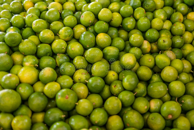 Limes at a market in Mexico stock image