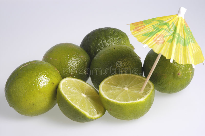 Limes with parasol royalty free stock photos