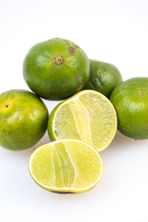 Limes on the white background. Photo of Limes on the white background stock image