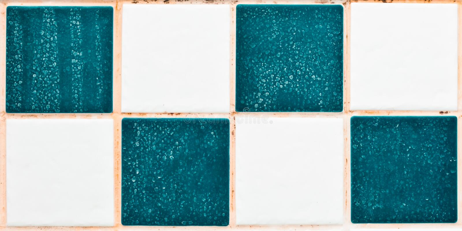 Limescale in bathroom. Close up of bathroom tiles showing mould and limescale royalty free stock images