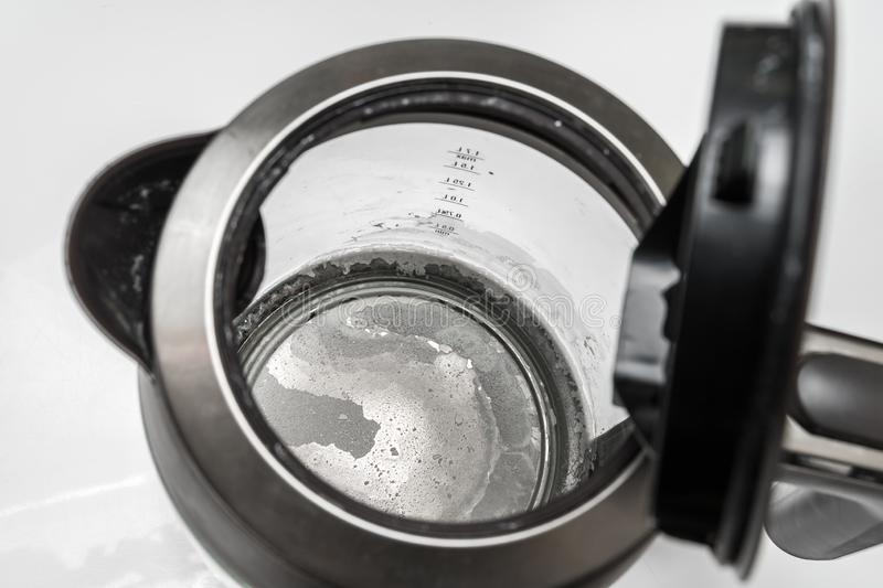 Limescale at the bottom of kettle - hard water concept. Limescale at the bottom of kettle - hard water and calcium concept stock photos