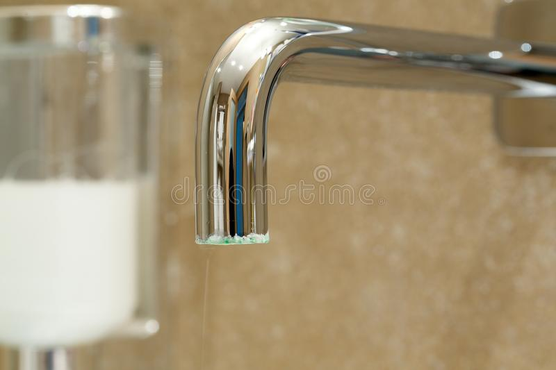 Limescale on a exterior surface of a tap. Limescale on a tap in a bathroom.Close up stock images