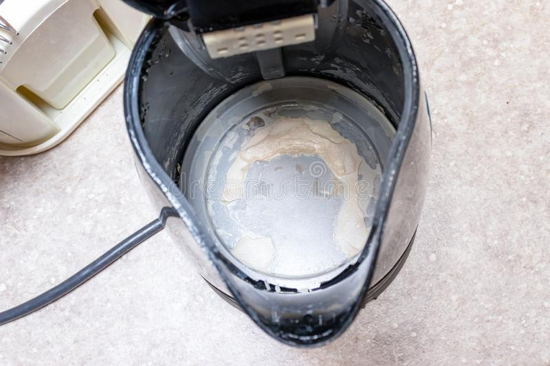Limescale, lime scale in old kettle in kitchen. A white, chalky residue of calcium carbonate. Household appliances repair caused. By hard water royalty free stock images