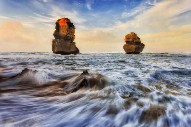 GOR 2 Apostles Beach Rise. 2 limestone apostles off Gibson steps beach at Twelve apostles marine park during sunrise sunlight royalty free stock photography