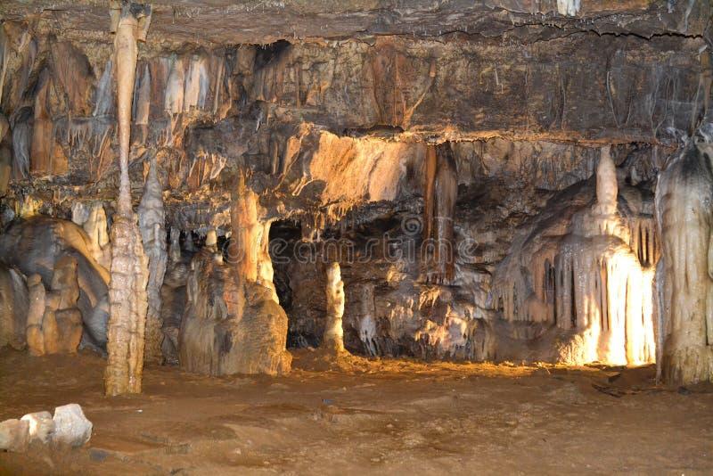 Limestone cave in Postojna. Postojna Cave (Slovene: Postojnska jama; : is a 24,120 m long karst cave system near Postojna, southwestern Slovenia royalty free stock photo