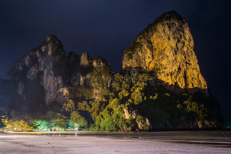 Limestone cliffs of Railay Beach by night in Krabi, Thailand royalty free stock photography