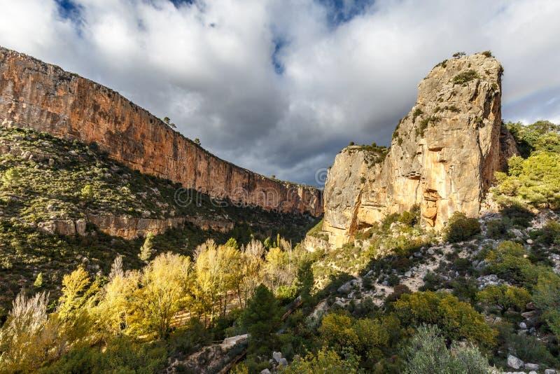Limestone cliffs of Turia canyon lit up by the sun near Chulilla stock image