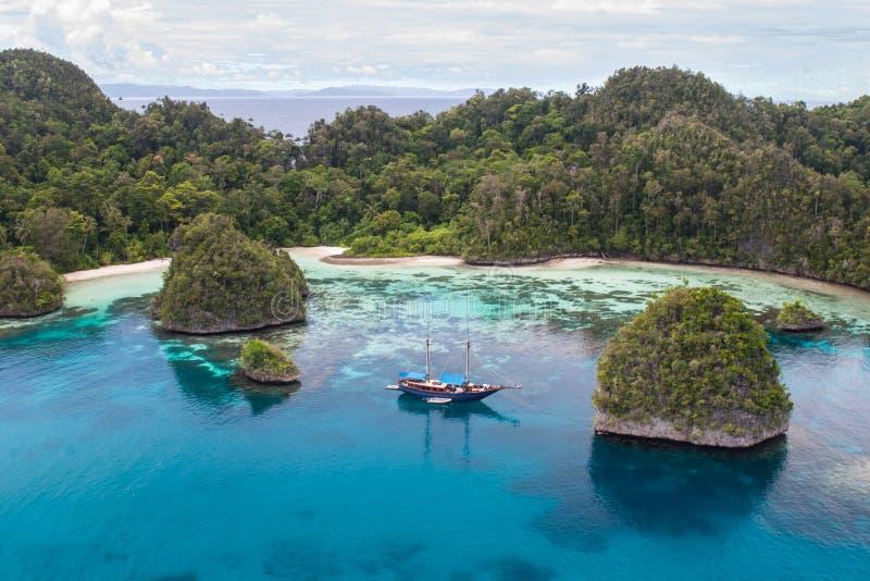 Limestone Islands and Peaceful Lagoon in Raja Ampat. Rugged limestone islands surround a beautiful, tropical lagoon in Raja Ampat, Indonesia. This remote region royalty free stock photo