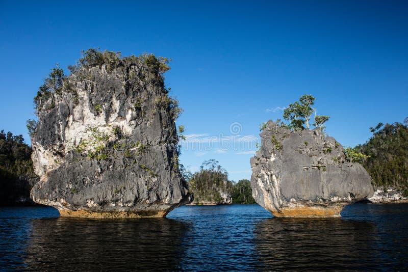 Limestone Islands in Raja Ampat Lagoon. Limestone islands are found in Raja Ampat, Indonesia. This remote region is home to extraordinary marine biodiversity and stock photography