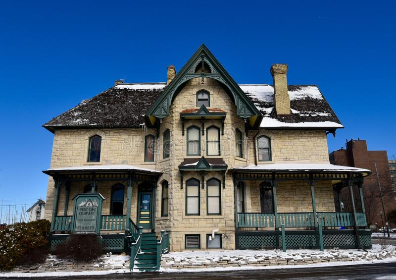 Limestone Italianate. This is a Winter picture of a large home located in Waukesha, Wisconsin. This 19th Century lime rock house is an example of Italianate stock photo