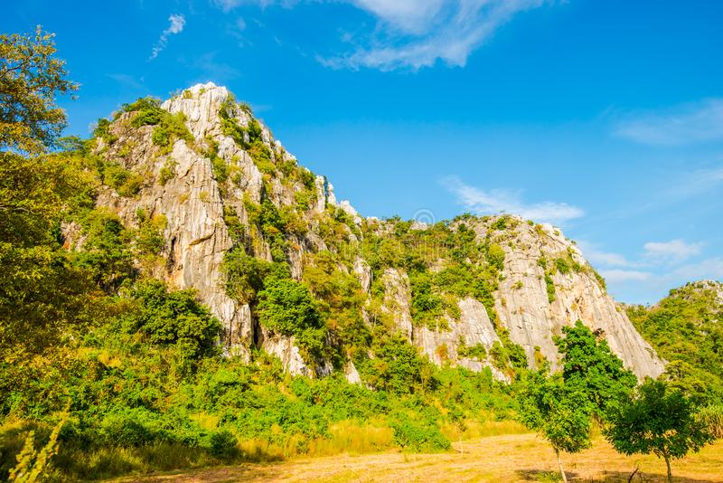 Limestone mountains with bright sky3. Limestone mountains are found in the countryside of Thailand stock photography