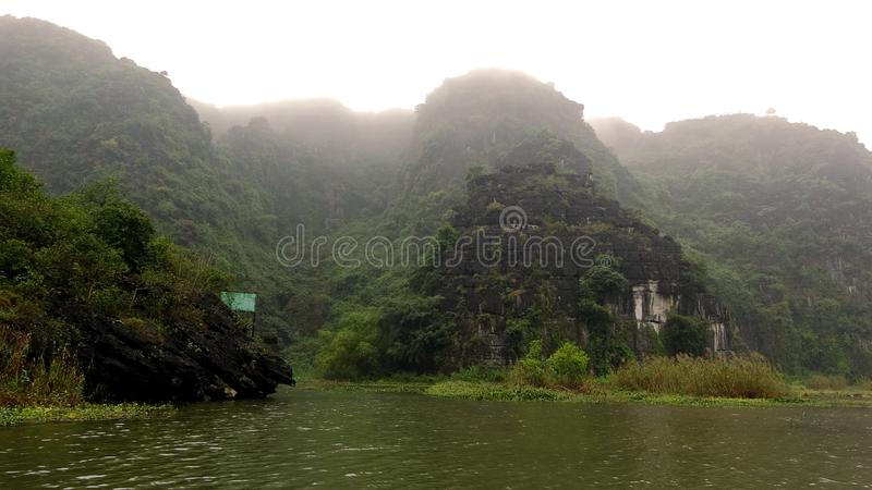 Limestone mountains stretch themselves out of the water royalty free stock photo