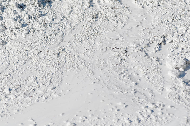 Limestone in natural light diffused water. Mountain of limestone waste in the industrial zone stock photography