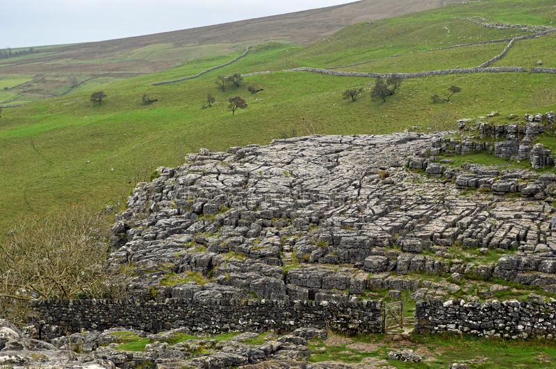 Limestone pavement above malham cove yorkshire uk. A limestone pavement is a natural karst landform consisting of a flat, incised surface of exposed limestone stock photos
